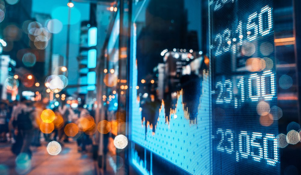 Stock market quotes over out of focus City scene