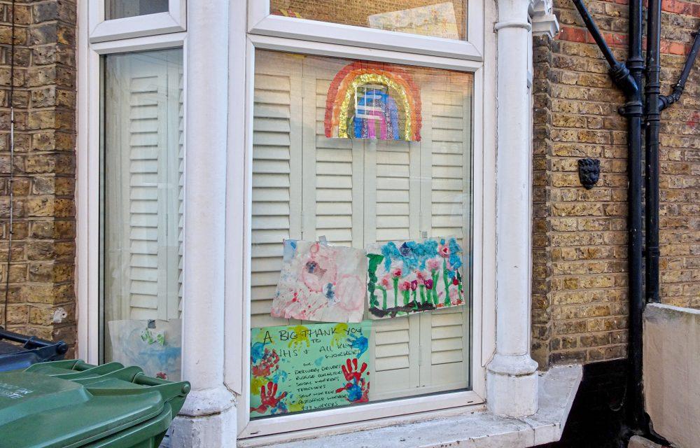Ground floor window with children's paintings