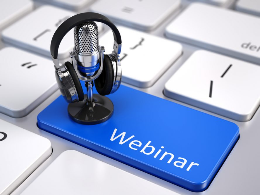 Small microphone and headphones on a laptop button named webinar.