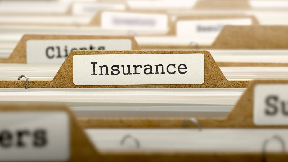 Image of file dividers with one which shows the word 'insurance' being in focus.
