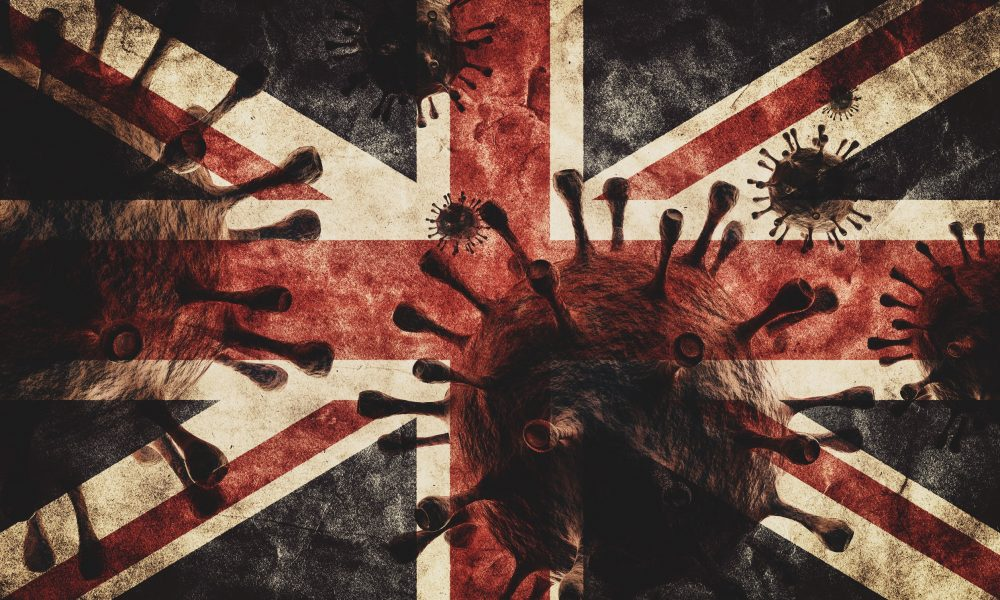 Depiction of COVID-19 viruses superimposed on a Union flag.