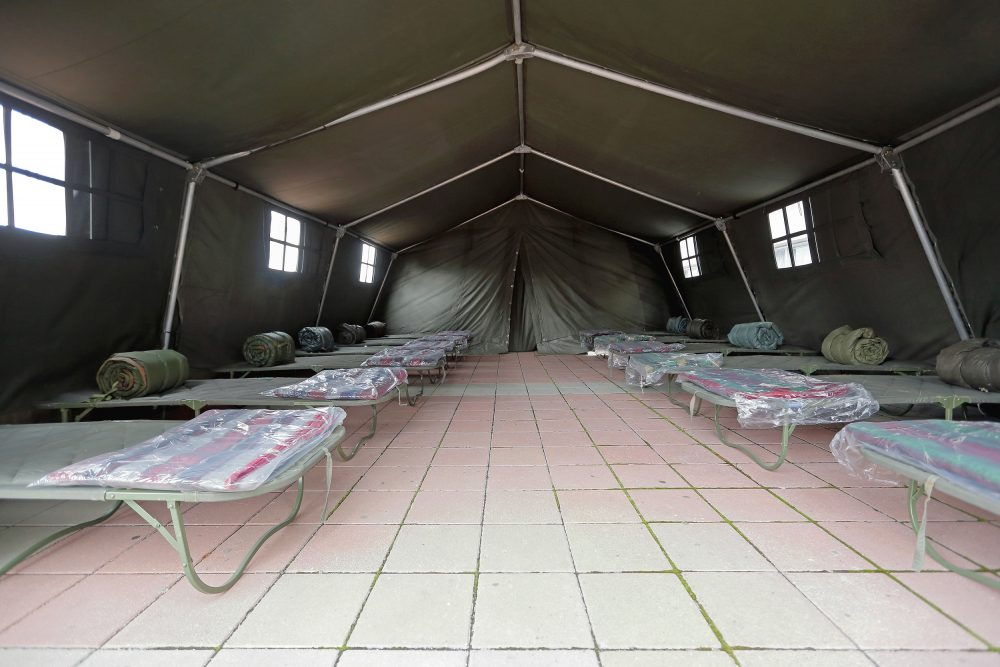Tent with camp beds set up by a relief agency.