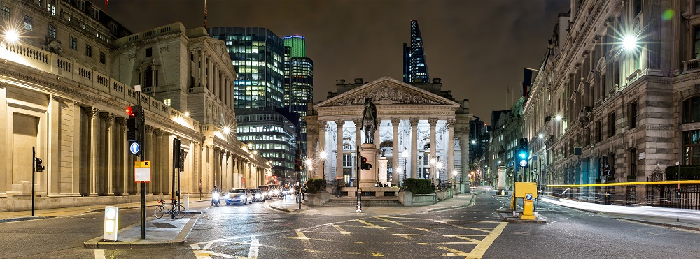 Image of the Royal Stock Exchange in London, taken at night.