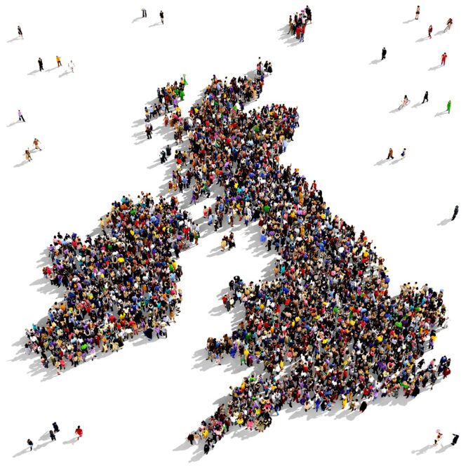 Aerial view of people on a white background, all standing together in the shape of the UK and the Republic of Ireland.
